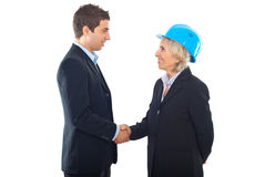 Handshake architect woman and businessman royalty free stock images