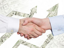 A handshake and arrows made of dollar notes. Stock Image