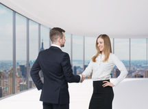 Handshake as a concept of successful deal. New York panoramic office background. Royalty Free Stock Photo