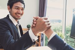 Handshake asian of business office partnership stock images