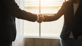 Handshake between attorneys and clients after agreeing to enter into a contract. For a court case. In the hope of victory over legal fighters royalty free stock photo