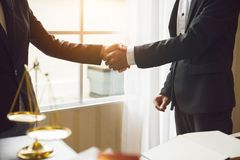 Handshake between attorneys and clients. After agreeing to enter into a contract for a court case. In the hope of victory over legal fighters royalty free stock images