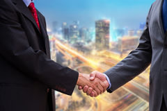 Handshake on background of buildings Royalty Free Stock Photo