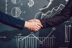 Handshake. Background with charts Stock Photos