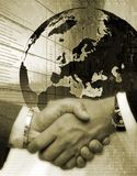 Handshake on background drawing globe Stock Image