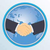 Handshake on the background of globe. Royalty Free Stock Images