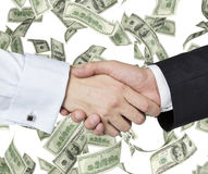 Handshake and banknote Stock Image