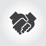 Handshake black flat icon. Symbol of relationship, friendship, partnership, support. Graphic logo Royalty Free Stock Photography