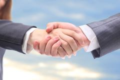 Handshake in the blue Stock Photos