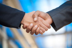 Handshake,blurry background Stock Images
