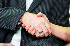 Handshake- boss and worker Royalty Free Stock Images
