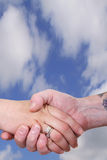 Handshake business. Business handshake between a man and a woman outdoors Royalty Free Stock Image