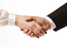Handshake. Business agreement, a handshake of female and male hands stock photo