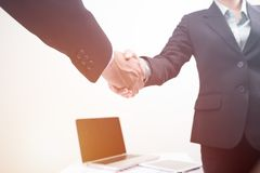 Handshake business agreement of partner business man and woman Stock Images