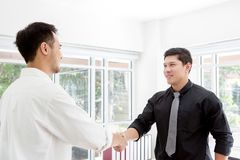 Handshake. Business associate shaking hands in office. Two businessmen shaking hands in office. stock images
