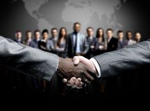 Handshake  on business background Stock Image