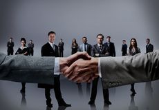 Business handshake and business people. Royalty Free Stock Image