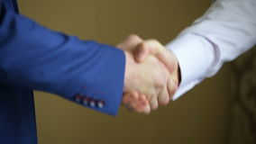 Handshake, business, blue suit, white shirt uncertain handshake. stock footage