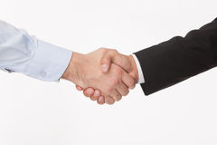 Handshake. Business handshake and business people concepts. Two men shaking hands isolated on white background royalty free stock photography