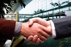 Handshake at business center. Business men handshake at business center Stock Photos