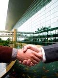 Handshake at business center. Business men handshake at business center Royalty Free Stock Photo