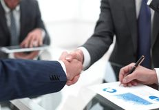 Close up.handshake of business partners. Handshake business colleagues in office royalty free stock photography