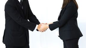 Handshake of business man and woman in strategic relationships. On white background royalty free stock images