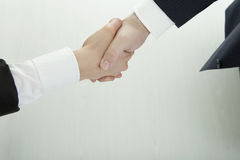 Handshake of business man and woman in suits Stock Images