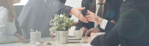 Handshake on a business meeting. Panorama of handshake on a business meeting stock photos