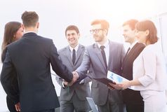 Welcome and handshake of business partners on the briefing. Handshake of business partners on the briefing Stock Images