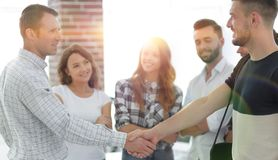 Handshake business partners in the creative office. stock photos
