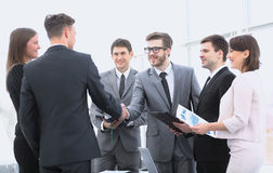 Handshake of business partners before the financial transaction Stock Photos