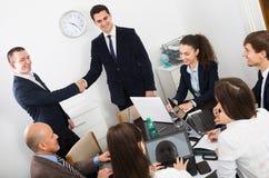 Handshake between business partners Stock Photos