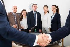 Handshake between business partners Stock Images