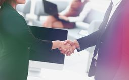Handshake business partners at the negotiating table. royalty free stock images