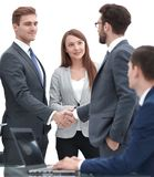Handshake business partners after signing a contract stock images