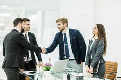 Handshake of business partners after signing the contract in the Stock Photos