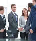 Handshake business partners after signing a contract.  royalty free stock photo