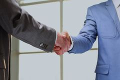 Handshake of business partners after signing promising contract. Handshake of business partners after signing promising contract Royalty Free Stock Image
