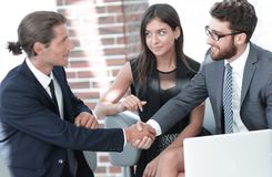 Handshake business partners,sitting on the sofa stock images