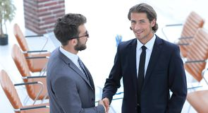 Handshake business partners to the conference room Royalty Free Stock Images