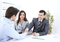 Handshake business partners in the workplace Stock Photography