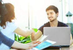 Handshake business partners in the workplace Stock Image