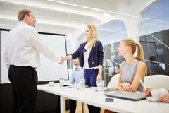 Handshake between business people Stock Photo