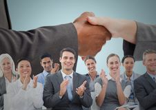 Handshake with business people and blue background. Digital composite of Handshake with business people and blue background Stock Images