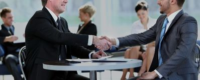 Concept of partnership - handshake of business partners Royalty Free Stock Photos
