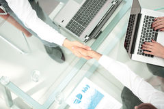 Handshake between business people in a modern office Royalty Free Stock Photography