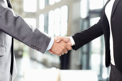 Handshake. Business people handshake at office stock photography