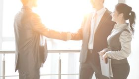 Handshake business people in the office. the concept of cooperation royalty free stock image