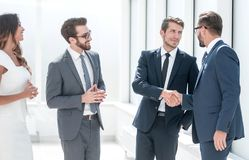 Handshake business people in the office royalty free stock photography